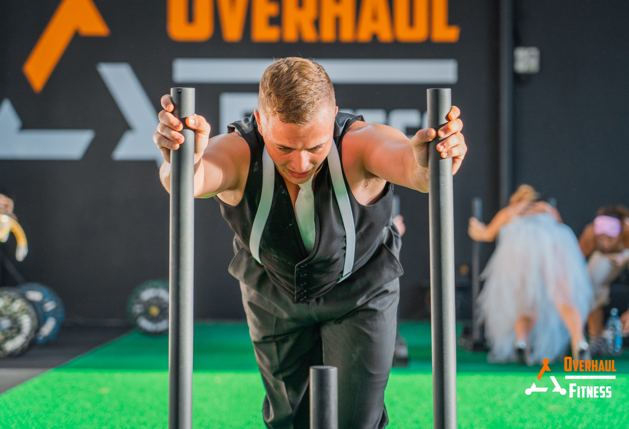 Strong guy doing sled pushes